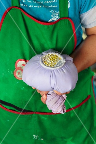 A piping bag filled with dough for fermented rice noodles, Vientiane, Laos