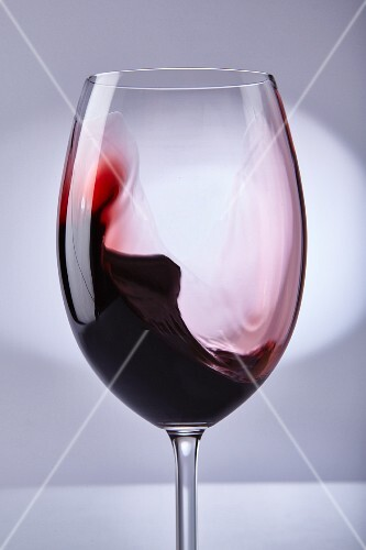 Red wine swilling in a glass