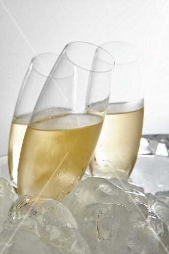 Glasses of Prosecco surrounded by ice cubes