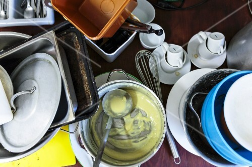 A pile of washing up in a pub kitchen, Norwich, UK
