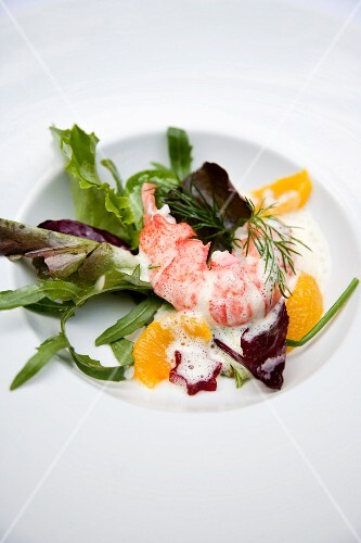 Lobster on a mixed leaf salad with orange butter