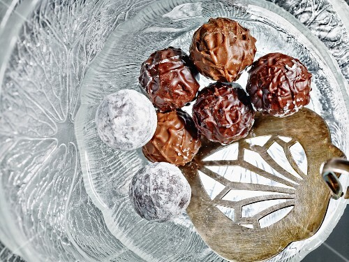 Truffle pralines with light and dark chocolate on a glass plate