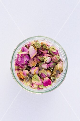 Dried rose petals in a glass