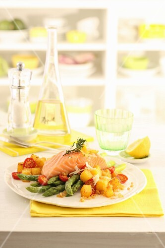 Salmon confit with green asparagus, crispy diced potatoes and goat's cheese
