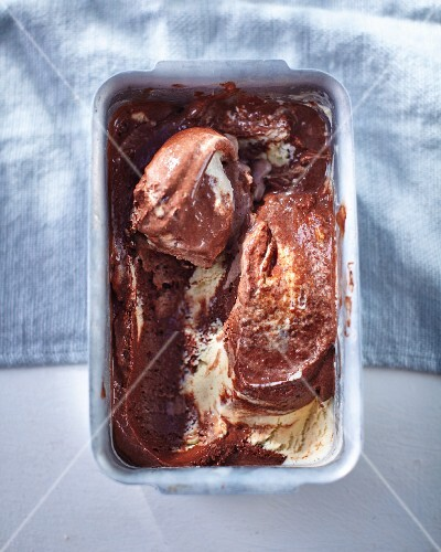 Chocolate and vanilla ice-cream in an aluminium tub