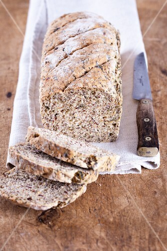 Spelt and wild garlic bread with flax seeds, sliced