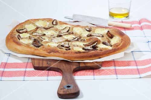A pizza with porcini mushrooms and brie