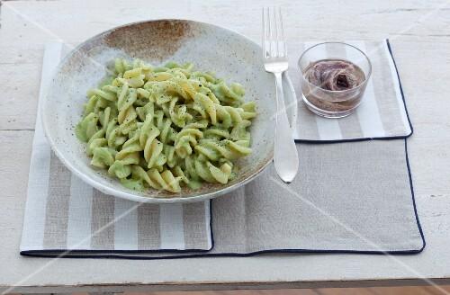 Fusilloni con salsa alle erbe (large fusilli pasta with a herb sauce, Italy)