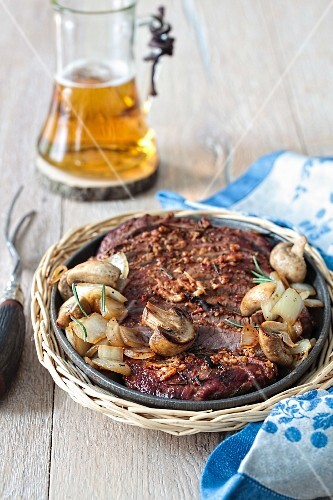 Whisky-marinated flank steak with mushrooms and onions