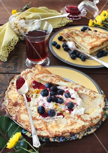 Vanilla crepes with blueberries, jam, cottage cheese and passion fruit