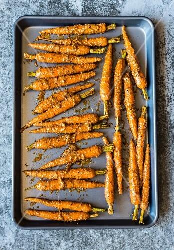 Tandoori carrots on a baking tray