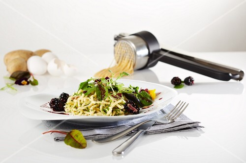 Buttered egg noodles with a wild herb salad and a blackberry dressing