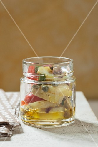 Potato salad with caper and tomatoes in a jar