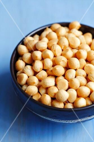 Mini choux pastry balls in a ceramic bowl