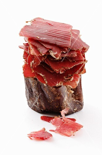 Smoked beef on a white surface (South Tyrol)