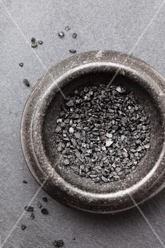 A bowl of black vulcan salt (seen from above)