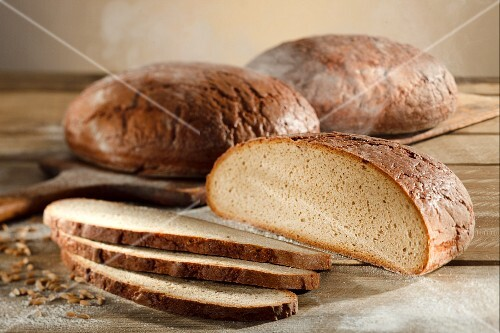 Three loaves of country bread (wheat and rye) with rye grains