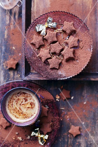 Star-shaped chocolate truffles with almonds and cocoa powder