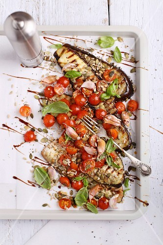 Grilled aubergines with tomatoes, garlic and fresh basil