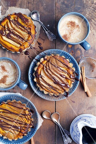 Vegan pear and pumpkin tartlets drizzled with chocolate