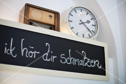 A blackboard in the 'Kapstachelbeere' pâtisserie, Berlin, Germany