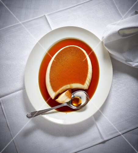 Creme caramel with a bite taken out