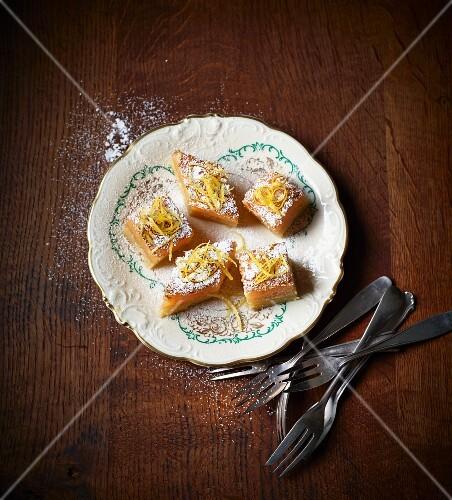 Sunshine cake with lemon zest and icing sugar