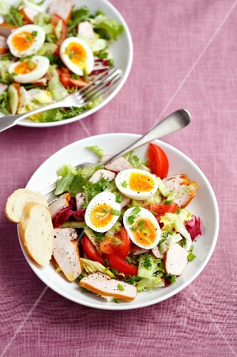 Salad with smoked chicken breast, cherry tomatoes, cucumber and boiled eggs