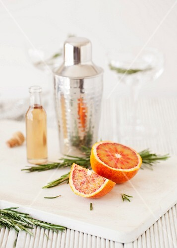 Ingredients for making a blood orange and rosemary martinis
