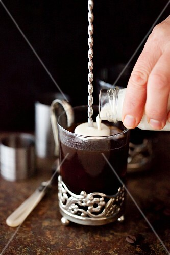 Black coffee with liqueur and cream