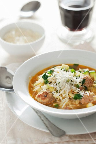 Orzo soup with meatballs, courgette and Parmesan cheese