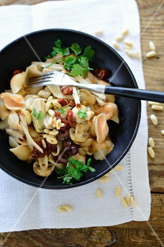 Pasta Valentino (pasta with artichokes, olives, mushrooms and pine nuts, Italy)