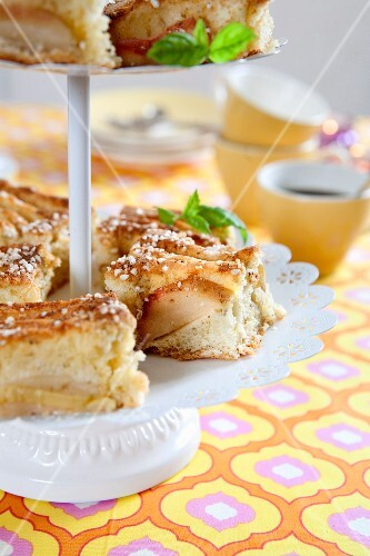 Slices of apple tray bake cake on a cake stand