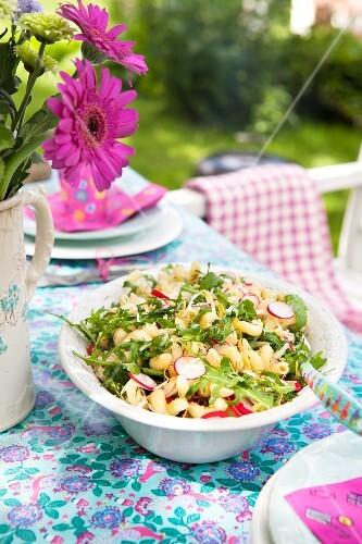 Pasta salad with radishes, rocket and lemon zest