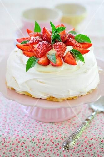 Strawberry pavlova on a cake stand