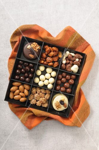 Various pralines and sweets in a box