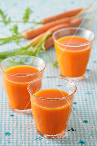 Three glasses of carrot juice