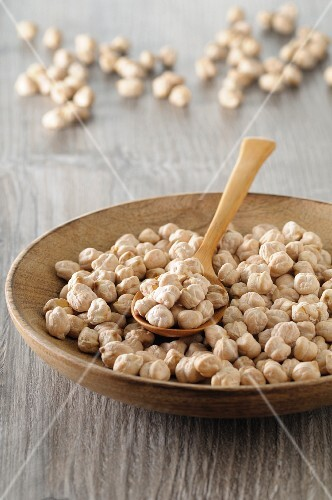 Chickpeas in a wooden bowl with a spoon