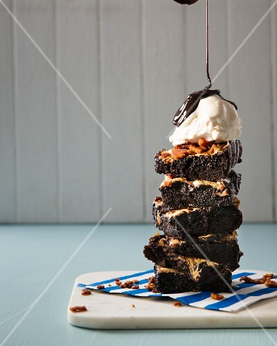 Gooey chocolate brownies with bacon, marshmallows, vanilla ice cream and chocolate sauce