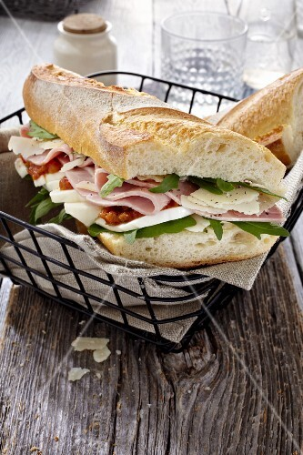 Baguette sandwich with ham, mozzarella, rocket and Parmesan cheese (Italy)