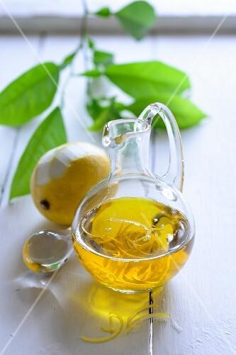 Lemon oil in a glass jug