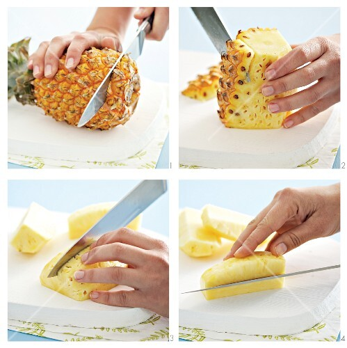 A pineapple being peeled and sliced