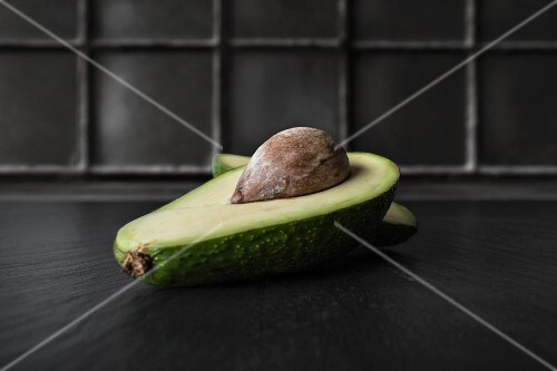A halved avocado with a stone