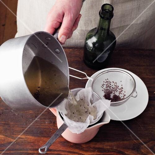 Psyllium wine à la Hildegard von Bingen being sieved