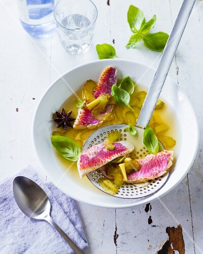 Oriental-style red mullet fillets in ginger broth