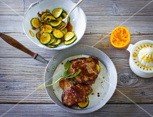 Stuffed orange and veal escalope with Parma ham and fried courgette