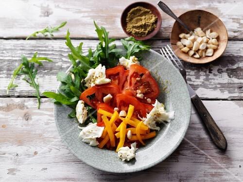 Tomato and mango salad with moringa vinaigrette