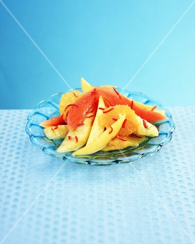 Chilli and jasmine fruit salad on a glass plate