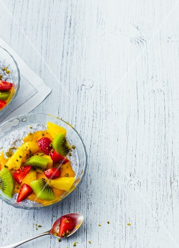 Vegan coconut and chia pudding with mango sauce