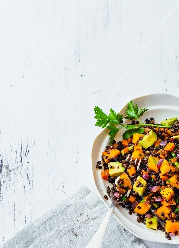 Vegan beluga lentil salad with dates, mango and avocado